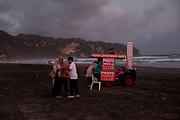 Foto Langsung Jadi (Photos Immediately) on Parangtritis Beach at dusk. Special Region of Yogyakarta, Indonesia. August 21, 2018
