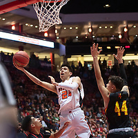 Gallup Bengal Quinn Atazhoon (24) drives to the basket during their 4A boys NMAA State Basketball quarterfinal playoff game against Espanola Valley Sundevils at Dreamstyle Arena (The Pit) Wednesday night in Albuquerque.