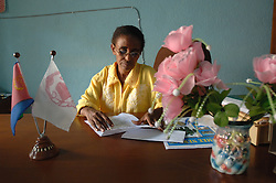 Tsion sits inside the Hamade office in Barentu, Eritrea August 25, 2006. Tsion was a fighter in the struggle against Ethiopia. (Photo by Ami Vitale)