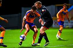 Ryan Sweeney of Mansfield Town gets the ball away from Anthony Scully of Lincoln City - Mandatory by-line: Ryan Crockett/JMP - 06/10/2020 - FOOTBALL - One Call Stadium - Mansfield, England - Mansfield Town v Lincoln City - Leasing.com Trophy
