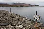 Disused sign and pier stones near Old Ferry House, now a remote self-catering house at Grasspoint, Loch Don, Isle of Mull, Scotland. Until 1881 a regular packet boat operated between Oban and Grass Point. This was replaced that year by a daily steamer service from Oban to Tobermory. Until that time, cattle from Rum and Eigg were transported by boat to Croig on Mull's north coast, and then driven across the island to Grass Point, on their way to the mainland. Parts of the old drover's route are still visible. The old stone quay is no longer used, except by occasional leisure craft. Grass Point means 'the field of the rock' in Gaelic.