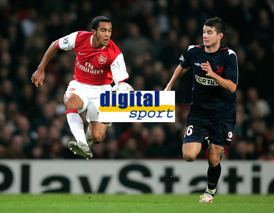 Photo: Tom Dulat.<br /> Arsenal v Slavia Prague. Group H, UEFA Champions League. 23/10/2007.<br /> Daniel Pudil of Slavia Prague and Theo Walcott of Arsenal with the ball.