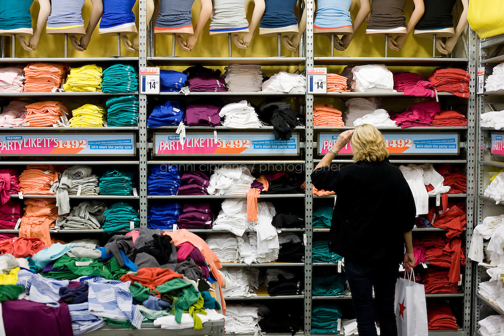 4 October, 2008. A customer check items on sale in the Old Navy store of 34th street (between Broadway and 7th ave). As the financial crisis spread last month, many retailers hit the panic button, offering more generous discounts than they did at the same time last year. But the promotions did little to convince cautious shoppers to open their wallets.<br /> <br /> ©2008 Gianni Cipriano for The Wall Street Journal<br /> cell. +1 646 465 2168 (USA)<br /> cell. +1 328 567 7923 (Italy)<br /> gianni@giannicipriano.com<br /> www.giannicipriano.com