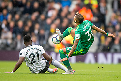 September 22, 2018 - Roberto Pereyra of Watford is fouled by Timothy Fosu-Mensah of Fulham during the Premier League match between Fulham and Watford at Craven Cottage, London, England on 22 September 2018. Photo by Salvio Calabrese. (Credit Image: © AFP7 via ZUMA Wire)
