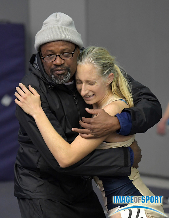 Feb 23, 2018; Seattle, WA, USA; UC Davis Aggies distance coach Jose Luiz Barbosa (left) embraces Haley Adel after the women's  5,000m during the MPSF Indoor Championships at Dempsey Indoor.