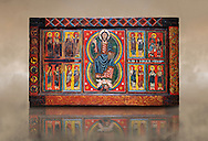 Painted wooden panel of the Altar of d'Ix showing Christ Patocrator flanked by the 12 apostles. From the Church of Sanit Matin d'Ix, La Guinguetta d'Ix, Alta Cerdanya, Spain.  National Art Museum of Catalonia, Barcelona 1958. Ref: MNAC 15802. .<br /> <br /> If you prefer you can also buy from our ALAMY PHOTO LIBRARY  Collection visit : https://www.alamy.com/portfolio/paul-williams-funkystock/romanesque-art-antiquities.html<br /> Type -     MNAC     - into the LOWER SEARCH WITHIN GALLERY box. Refine search by adding background colour, place, subject etc<br /> <br /> Visit our ROMANESQUE ART PHOTO COLLECTION for more   photos  to download or buy as prints https://funkystock.photoshelter.com/gallery-collection/Medieval-Romanesque-Art-Antiquities-Historic-Sites-Pictures-Images-of/C0000uYGQT94tY_Y
