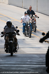 Paul Ousey, Greg McFarland, Brent Mayfield and Doug Feinsod ride through the tunnel onto the Daytona International Speedway on Thursday before the Friday morning start of the Motorcycle Cannonball Cross-Country Endurance Run. Daytona Beach, FL, USA. September 4, 2014.  Photography ©2014 Michael Lichter.