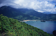 ATLANTIC COAST, Ilha Grande, Brazil, South America. Coastline south of Rio de Janerio, tourist destination and ecological biosphere. Sandy beaches and Atlantic Rainforest. Temperate rainforest micro-climate. A region that is being developed for eco-tourism and is a popular holiday destination for locals and foreigners.