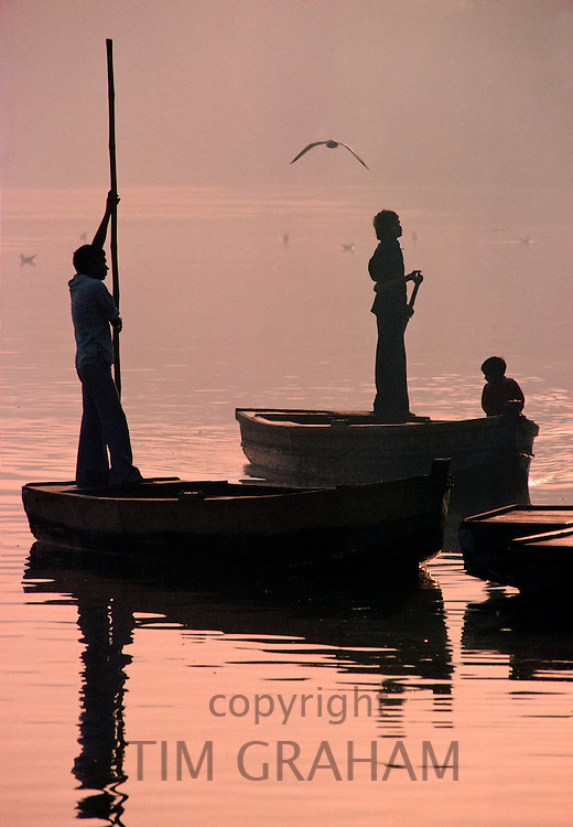 Indian men at work on the River Ganges, India