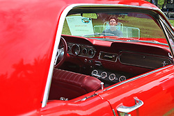 June 18, 2017 - Miami, FL, USA - Fifteen-year-old Michael McDonald takes in a brief moment of sunshine as he displays his 1967 Ford Mustang. On Father's Day, Sunday, June 18, 2017 the Barnacle Historic State Park held its Father's Day celebration called ''Cars and Cigars,'' a combination of vintage cars, music, picnics and biergarten. (Credit Image: © Carl Juste/TNS via ZUMA Wire)