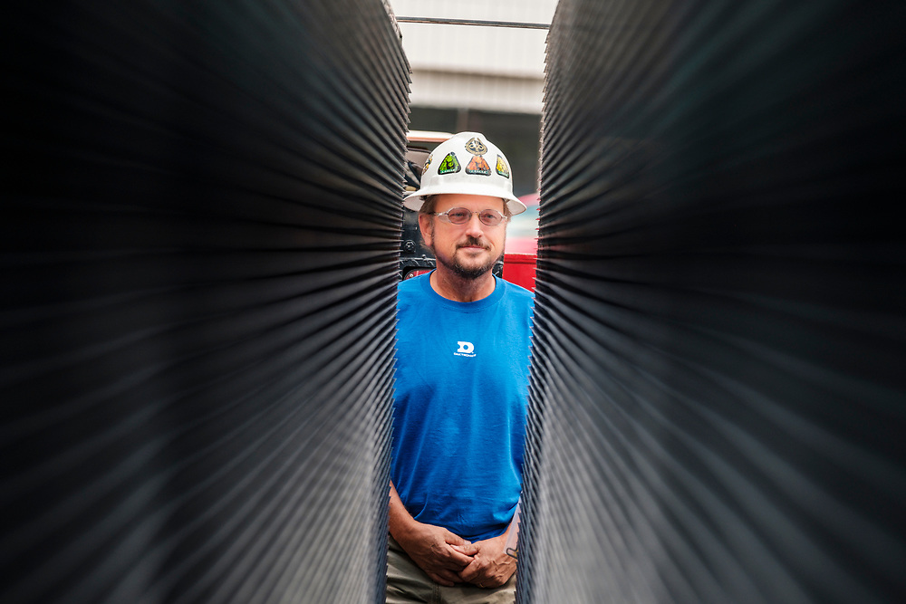 Dwayne Mace, Regional Digital Technician, from Lamar Advertising Company standing between two LED panels on site where technicians from Lamar were installing a digital billboard structure along Wards Road in Lynchburg, VA Wednesday, August 29, 2018. U.S. companies are investing in re-training efforts to fill a slew of open positions as a tight labor market and changing job requirements makes it hard to find qualified staffers.<br /> CREDIT: Justin Ide for The Wall Street Journal<br /> RETRAIN
