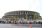 General overall view of women's competitors running past Naitonal Stadium, the site of the 2020 Olympic Games track and opening and closing ceremonies, during the Marathon Grand Championship, Sunday Sept. 15 2019, in Tokyo. (Agence SHOT/Image of Sport via AP)
