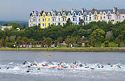 SWIMMERS TAKING PART IN THE THE ISLAND GAMES, RAMSEY, ISLES OF MAN.