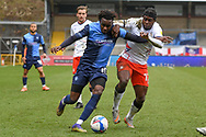 Wycombe Wanderers forward (on loan from Leicester City) Admiral Muskwe (15) battles for possession with Luton Town midfielder Pelly-Ruddock Mpanzu (17) during the EFL Sky Bet Championship match between Wycombe Wanderers and Luton Town at Adams Park, High Wycombe, England on 10 April 2021.