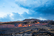 a lava boat or lavaberg (large chunk of partially hardened lava) floats down the lava river flowing through Kapoho from Fissure 8 of the Kilauea Volcano east rift zone near Pahoa, Puna District, Hawaii Island ( the Big Island ), Hawaiian Islands, U.S.A.; heat waves rising from the lava shimmer the air, distorting the view of everything beyond the edge of the river