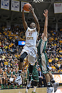 WICHITA, KS - NOVEMBER 14:  Forward Cleanthony Early #11 of the Wichita State Shockers drives to the basket against the William & Mary Tribe during the first half on November 14, 2013 at Charles Koch Arena in Wichita, Kansas.  (Photo by Peter G. Aiken/Getty Images) *** Local Caption *** Cleanthony Early