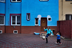 "Veronika Sindelárová's oldest child Rinaldo Gina, 2, plays outside their home with her half-sister Vanesa Sindelárová, 8, in Ostrava, Czech Republic on March 1, 2012. Veronika was one of 18 Roma children who were represented in the D.H. and Others v. Czech Republic case, the first challenge to systemic racial segregation in education to reach the European Court of Human Rights. When this case was first brought in 2000, Roma children in the Czech Republic were 27 times more likely to be placed in ""special schools,"" intended for the mentally disabled, than non-Roma children. In 2007, the Grand Chamber of the European Court of Human Rights ruled that this pattern of segregation violated nondiscrimination protections in the European Convention on Human Rights. Despite this landmark decision, little change has occurred: the ""special schools"" have been renamed but follow the same substandard curriculum and Roma continue to be assigned to these schools in disproportionate numbers. The process of integration has barely begun."