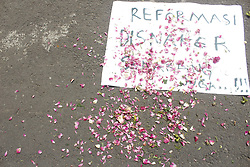 May 1, 2019 - Madiun, East Java, Indonesia - You can see a sprinkling of flowers on a white paper that says ''Reform of the Manpower Office [Disnaker] Now ... !!!'' at the end of the peaceful speech of the commemoration of International Labor Day on May 1, 2019 in Madiun City (Credit Image: © Ajun Ally/Pacific Press via ZUMA Wire)