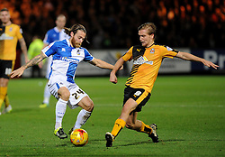 Stuart Sinclair of Bristol Rovers is challenged by Luke Berry of Cambridge United - Mandatory byline: Neil Brookman/JMP - 07966 386802 - 30/10/2015 - FOOTBALL - The Abbey Stadium - Cambridge, England - Cambridge United v Bristol Rovers - Sky Bet League Two