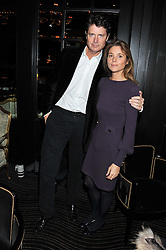 DR MARK CECIL and his wife KATE at an evening of Cabaret by Nicky Haslam held in the Beaufort Bar, The Ritz, London on 11th December 2011.