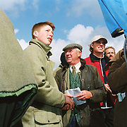 Spectators by the betting kiosks at the Tiverton Staghounds point-to-point steeplechases at Bratton Down, Barnstaple, Devon, UK