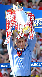 Arsenal's manager Arsene Wenger celebrates with the Barclaycard Premiership trophy after their match against Leicester City at Arsenal's Highbury Stadium, London.  THIS PICTURE CAN ONLY BE USED WITHIN THE CONTEXT OF AN EDITORIAL FEATURE. NO WEBSITE/INTERNET USE UNLESS SITE IS REGISTERED WITH FOOTBALL ASSOCIATION PREMIER LEAGUE.