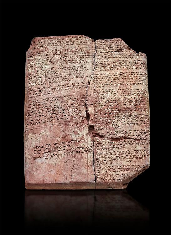 Hittite cuneiform clay tablet,  Hattusa, Hittite  Kingdom 1600-1200 BC, Bogazkale archaeological Museum, Turkey. Black background