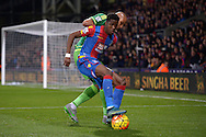 Wilfried Zaha of Crystal Palace blocks the ball from Younes Kaboul of Sunderland. Barclays Premier league match, Crystal Palace v Sunderland at Selhurst Park in London on Monday 23rd November 2015.<br /> pic by John Patrick Fletcher, Andrew Orchard sports photography.