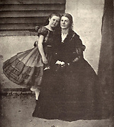 MRS. GREENHOW, THE CONFEDERATE SPY, WITH HER DAUGHTER, IN THE OLD CAPITOL PRISON from the book ' The Civil war through the camera ' hundreds of vivid photographs actually taken in Civil war times, sixteen reproductions in color of famous war paintings. The new text history by Henry W. Elson. A. complete illustrated history of the Civil war