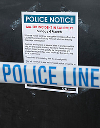 © Licensed to London News Pictures. 20/03/2018. Salisbury, UK. Police cordon tape and a note from the police explaining the events of March 4,  are placed at The Mill pub as police continue their investigation after former Russian spy Sergei Skripal and his daughter Yulia were poisoned with nerve agent. The couple where found unconscious on bench in Salisbury shopping centre. A policeman who went to their aid is currently recovering in hospital. Photo credit: Peter Macdiarmid/LNP