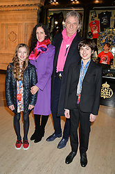 SIR PAUL SMITH with STEPHANIE DENYER and her children POPPY DENYER and ZANY DENYER at the opening night of Cirque du Soleil's award-winning production of Quidam at the Royal Albert Hall, London on 7th January 2014.