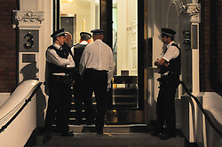 © Licensed to London News Pictures. 16/08/2012. London,UK.British police officers guard the Ecuadorian embassy where Wikileaks founder Julian Assange has sought political asylum  .  Photo credit : Thomas Campean/LNP
