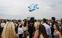© Licensed to London News Pictures. 21/04/2018. London, UK. Baloons being released as mourners attend the burial of traveller 'Queenie, Elizabeth Doherty at Kensal Green Cemetery in west London, following a funeral service in Cobham, Surrey. Elizabeth Doherty, whose son Paddy Doherty is known for appearing on My Big Fat Gypsy Wedding and winning Celebrity Big Brother 8, died of a heart attack earlier this month. Paddy Doherty claimed his mother has died of a 'broken heart' following the death of her husband almost a year ago. Photo credit: Ben Cawthra/LNP
