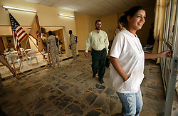 Alyaa Abdul Hassan Abbood, 23, a translator for the U.S. military, leaves the base of the 82nd Airborne to go to the local courthouse where they will give Iraqi civilians monetary compensation for damages caused by U.S. troops in Baghdad, Iraq, Sept. 27, 2003.