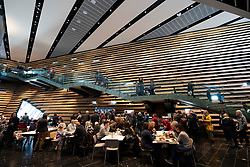 Interior of the new V&A Museum showing busy cafe and stairs on first weekend after opening in Dundee , Scotland, UK.
