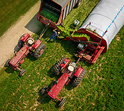 David Schlies works with freshly cut peas and oats to be used as feed for his cows at Old Settler's Dairy near Denmark wisconsin the combination is an alternate forage after he had a winter kill of his alfalfa. Farmers in the Mideast have had to become creative in many way after a tough winter and a cold and wet spring that delayed planting.