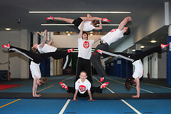 Backflipping Gymnasts - City of Glasgow Gymnastic Team warm up for their Sport relief mile which they will be doing backflips for. <br /> <br /> (l-R) Amy Regan (17), Cara Kennedy (14) (Flipping ), Sophie Terris (13), Craig Gibson (16) Megan Morrison (10) Douglas Ross (17) Flipping, and Orla Gallacher (15)