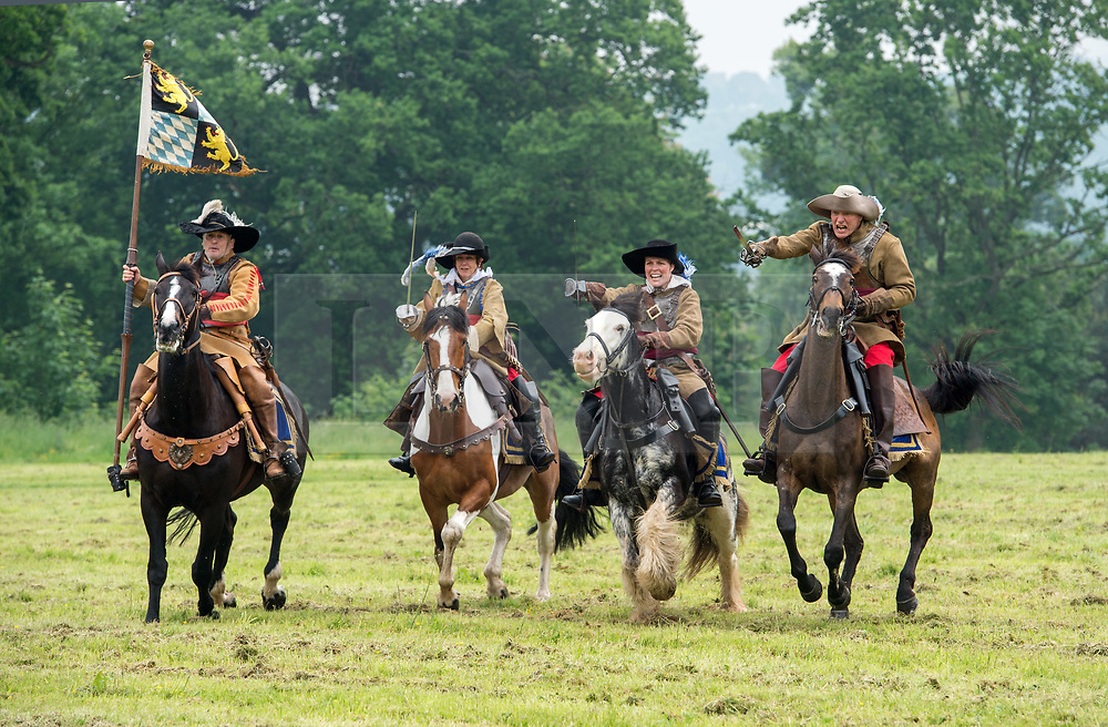 © Licensed to London News Pictures. 27/05/2018. Bristol, UK. The Sealed Knot English civil war reenactment society perform for the 375th anniversary of the Siege of Bristol at Ashton Court estate over the end of May Bank Holiday Weekend, with an explosive display of Cannon, Musket, Pike and Cavalry as the Sealed Knot re-enacts the Siege on the Battlefield. Photo credit: Simon Chapman/LNP