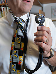 File photo dated 10/03/14 of a GP with a stethoscope. The number of family doctors leaving general practice in England slightly outstripped the number joining the profession in the first three months of the year, figures show.
