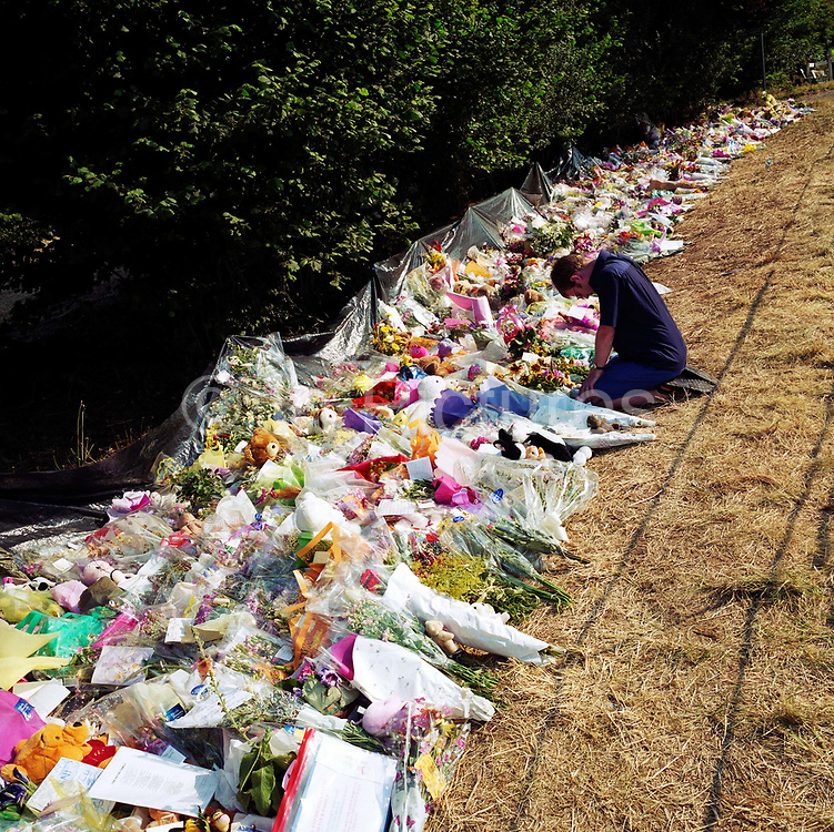 """A memorial has been placed where 'Sarah' died near the A29 in Pulborough, Sussex, England, UK. Were we to ignore this place where someone's life ended, the victim would just be a statistic but flowers are left to there too with touching poems and dedications written by family and loved-ones. One reads: """"A little Angel lent, not given/to be born on earth/and grow in Heaven/We have lost a Princess, but gained an Angel/To take you so soon is tragic we know/but when Jesus calls, you just have to go."""" From a project about makeshift shrines: """"Britons have long installed memorials in the landscape: Statues and monuments to war heroes, Princesses and the socially privileged. We lay wreaths to the ordinary who die suddenly - folk killed as pedestrians, as drivers or by alcohol, all celebrated on roadsides and cities with simple, haunting roadside remembrances."""