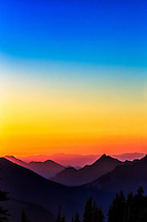 Spectacular Hurricane Ridge: Sunset seen from Hurricane Ridge, as the Olympic coastal mountains contrast with a kaleidoscope of colours, the result of a forest fires smoky haze, Olympic National Park, Washington, United States of America.
