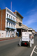 Horse drawn carriage and historical buildings, Old Town Sacramento, California
