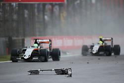 Nico Hulkenberg (GER) Sahara Force India F1 VJM09 and Sergio Perez (MEX) Sahara Force India F1 VJM09 pass debris from the Sauber C35 of Marcus Ericsson (SWE) Sauber F1 Team.<br /> 13.11.2016. Formula 1 World Championship, Rd 20, Brazilian Grand Prix, Sao Paulo, Brazil, Race Day.<br />  <br /> / 131116 / action press