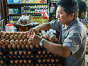 30 DECEMBER 2015 - BANGKOK, THAILAND:  An egg vendor sets up his market stall in Bang Chak Market. The market is supposed to close permanently on Dec 31, 2015. The Bang Chak Market serves the community around Sois 91-97 on Sukhumvit Road in the Bangkok suburbs. About half of the market has been torn down. Bangkok city authorities put up notices in late November that the market would be closed by January 1, 2016 and redevelopment would start shortly after that. Market vendors said condominiums are being built on the land.           PHOTO BY JACK KURTZ