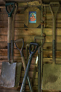 Volunteers' gardening tools and Padmasambhva Buddha at the Rivendell Buddhist Retreat Centre, East Sussex, England.