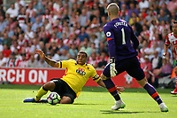 Football - 2016 / 2017 Premier League - Southampton vs. Watford<br /> Troy Deeney of Watford slides in to try and stop Southampton's Fraser Forster from clearing a backpass at St Mary's Stadium Southampton <br /> <br /> Colorsport/Shaun Boggust
