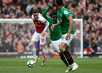 Football - 2018 / 2019 Premier League - Arsenal vs. Brighton & Hove Albion<br /> <br /> Mesut Ozil (Arsenal FC) attempt sto shake off Yves Bissouma Brighton & Hove Albion) at The Emirates.<br /> <br /> COLORSPORT/DANIEL BEARHAM