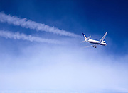 Airplane contrails with clouds, aerial view