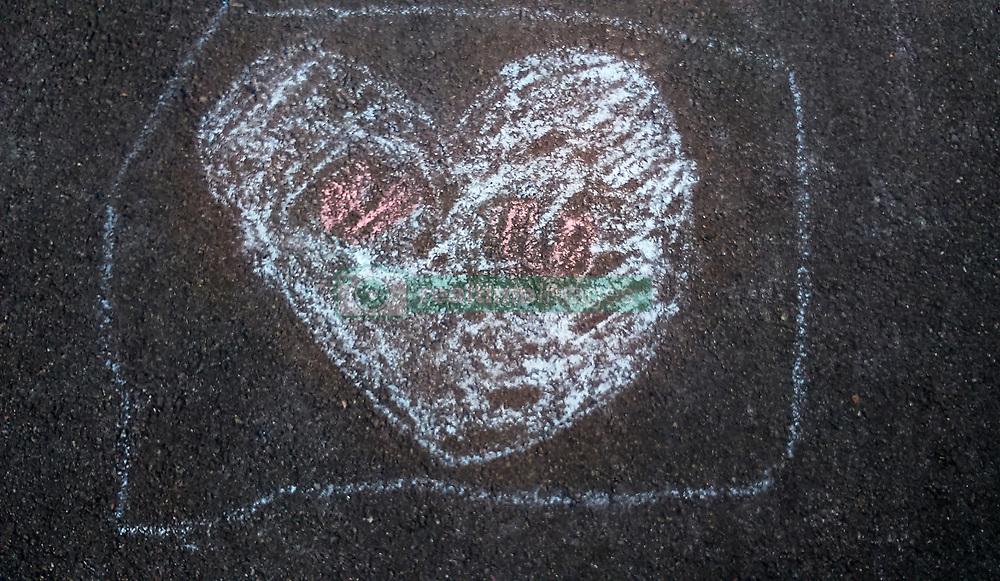 September 21, 2016 - heart drawn with chalk on asphalt (Credit Image: © Igor Goiovniov/ZUMA Wire)