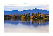 Backlit mountains and buildings in the morning at Lake Placid In the Adirondack Mountains of New York State, USA